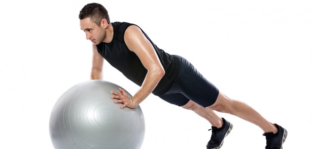 Man doing fitness exercise on pilates ball