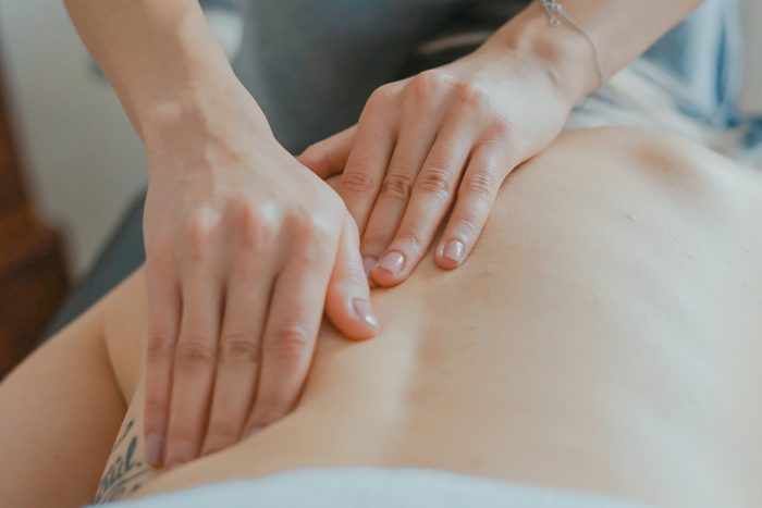 Person receiving massage or physiotherapy treatment